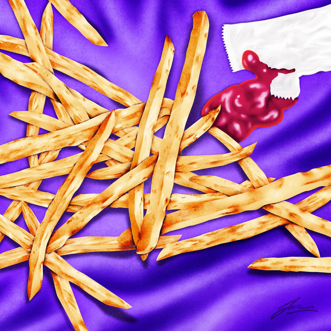 A pile of french fries lies atop a silky satin sheet. A packet of ketchup is ripped open and available for dipping.